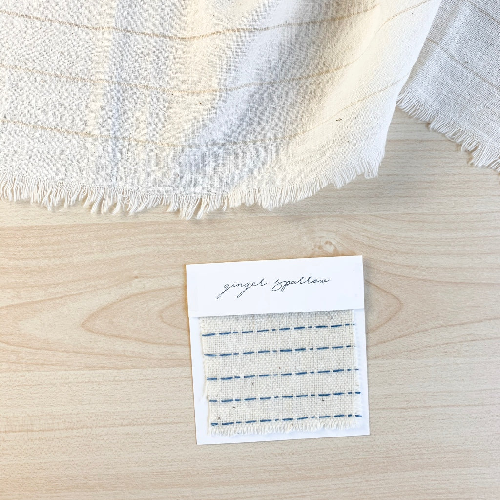 Handwoven Textile by Ginger Sparrow, a modern home decor brand. Featuring a blue ticking stripe woven on a soft ivory ground. Light and airy its perfect for #throwpillows #drapes #livingroomdecor #bedroomideas