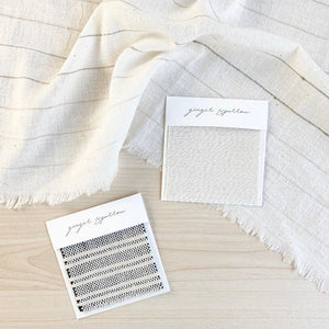 Handwoven Textile by Ginger Sparrow, a modern home decor brand. Featuring a heavyweight black and white striped fabric woven on a handloom. Sturdy and heavyeight its perfect for #throwpillows #drapes #livingroomdecor #bedroomideas