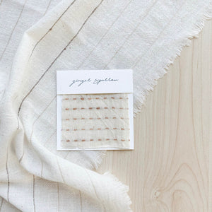 Handwoven Textile by Ginger Sparrow, a modern home decor brand. Featuring a brown ticking stripe woven on a soft ivory ground. Light and airy its perfect for #throwpillows #drapes #livingroomdecor #bedroomideas