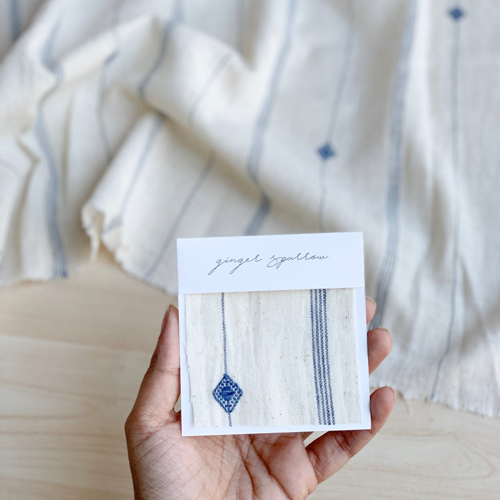 Handwoven Textile by Ginger Sparrow, a modern home decor brand. Featuring a blue diamond pattern woven, light and airy its perfect for #throwpillows #drapes #livingroomdecor #bedroomideas