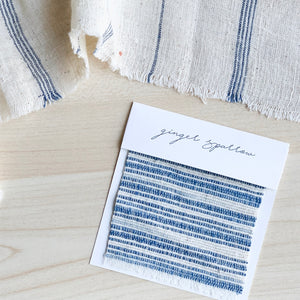Handwoven Textile by Ginger Sparrow, a modern home decor brand. Featuring a blue and ivory rugged stripes. Light and airy its perfect for #throwpillows #drapes #livingroomdecor #bedroomideas