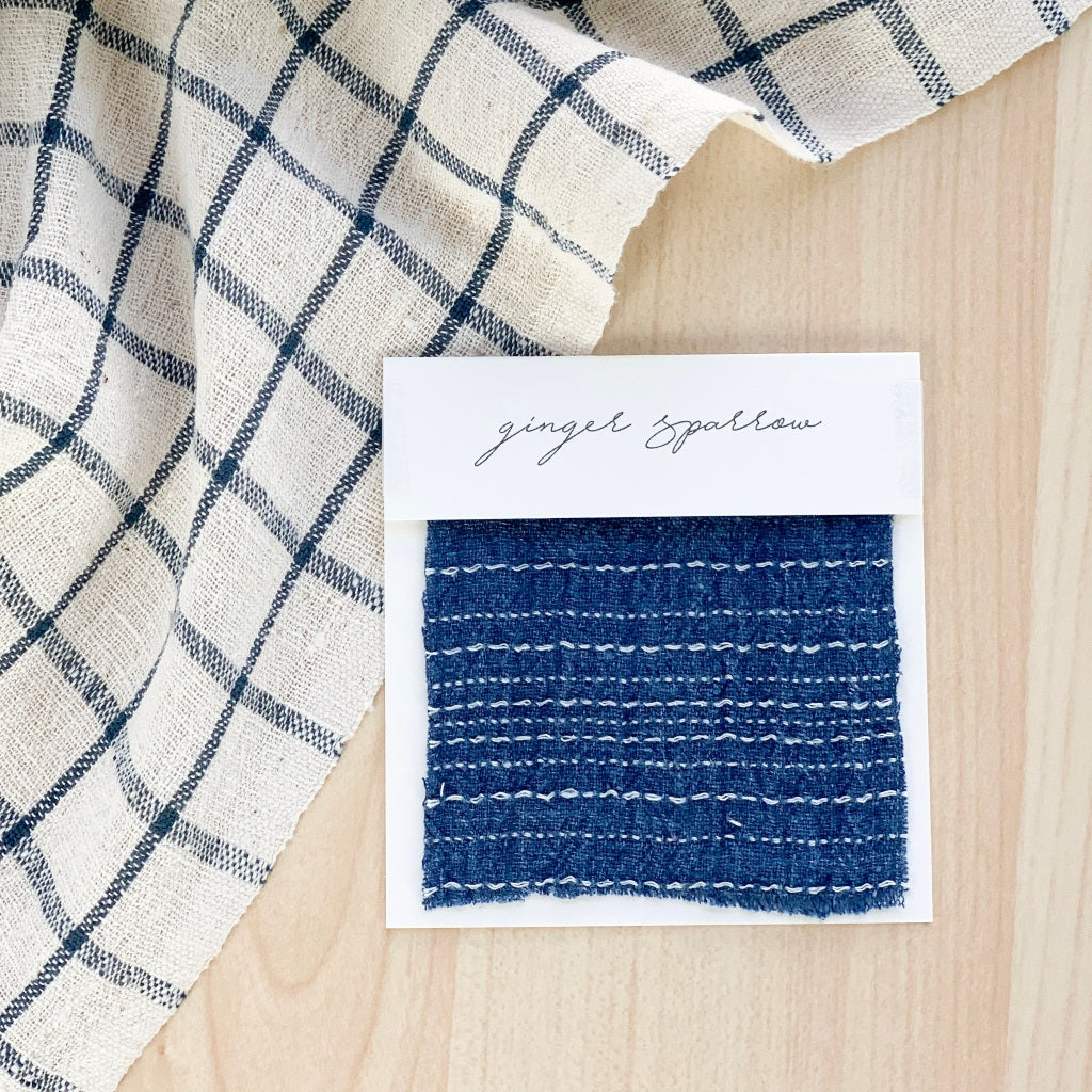 Handwoven Textile by Ginger Sparrow, a modern home decor brand. Featuring an indigo base witha  striped patternLight and airy its perfect for #throwpillows #drapes #livingroomdecor #bedroomideas