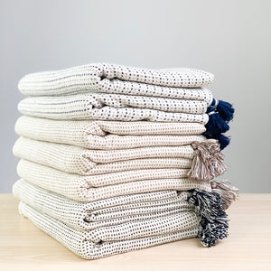 A soft ivory ticking striped throw in three colors by Ginger Sparrow. In 42x72 inch size featuring a striped weave it is perfect for #livingroomdesign and #bedroomdecorideas