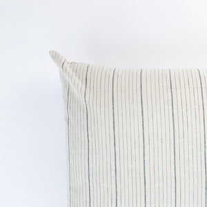 A soft ivory pillow featuring a charcoal striped pattern. Handcrafted by Ginger Sparrow, a modern home decor brand.