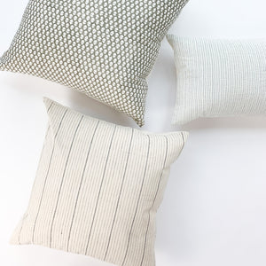 Handwoven Textile by Ginger Sparrow, a modern home decor brand. Featuring a charcoal black stripe pattern woven on a soft ivory ground. Light and airy its perfect for #throwpillows #drapes #livingroomdecor #bedroomideas