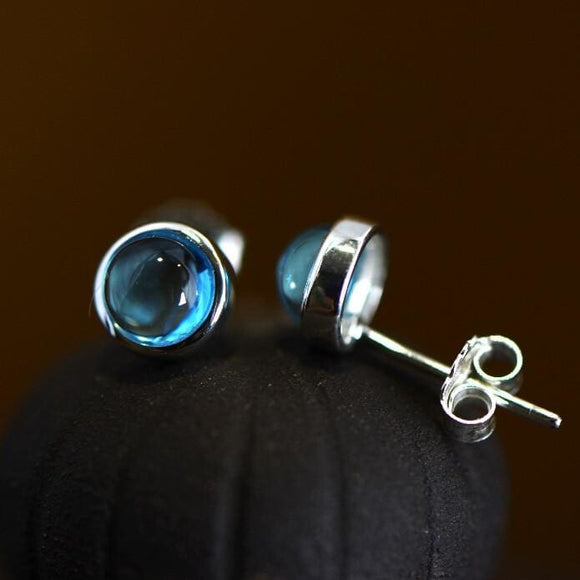 Sterling Silver Circle Blue Topaz Stud Earrings