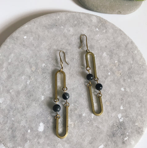 Kinetic long oval earrings with natural stone