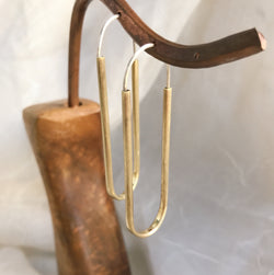 Hand-formed hammered brass and sterling hoops