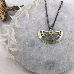 Moth wing domed necklace