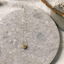 Simple brass dot necklace on sterling chain