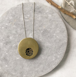 Hollow brass pebble circle cutout necklace
