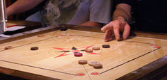 Carrom and Crokinole