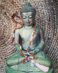 mala beads with buddha