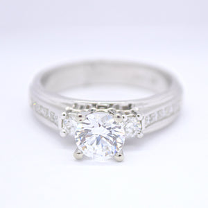 semi set diamond engagement ring with melee