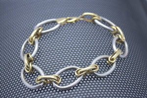 white and yellow gold rope bracelet