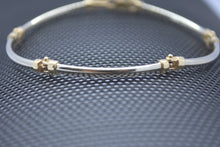 white and yellow gold curve bracelet