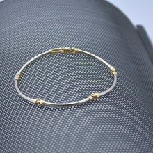 white and yellow gold curve link bracelet