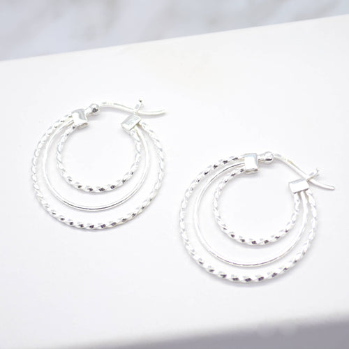 triple twist hoop silver earrings