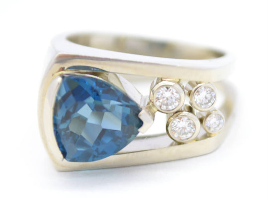 blue topaz and diamond white gold engagement ring