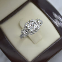 square cluster emerald cut engagement ring