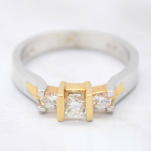 three stone diamond ring with two toned gold