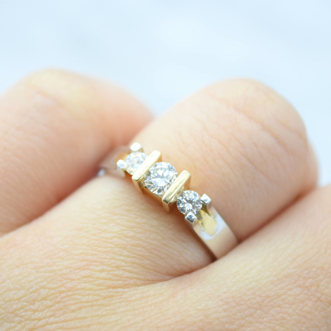 three stone diamond two toned engagement ring