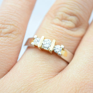 three stone diamond two toned gold ring