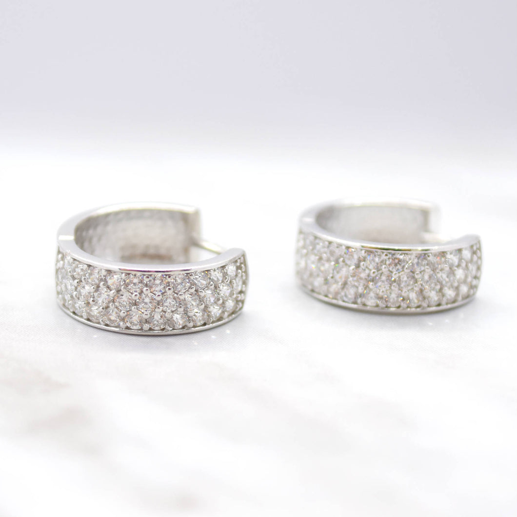 triple row cubic zirconia huggie earrings white gold