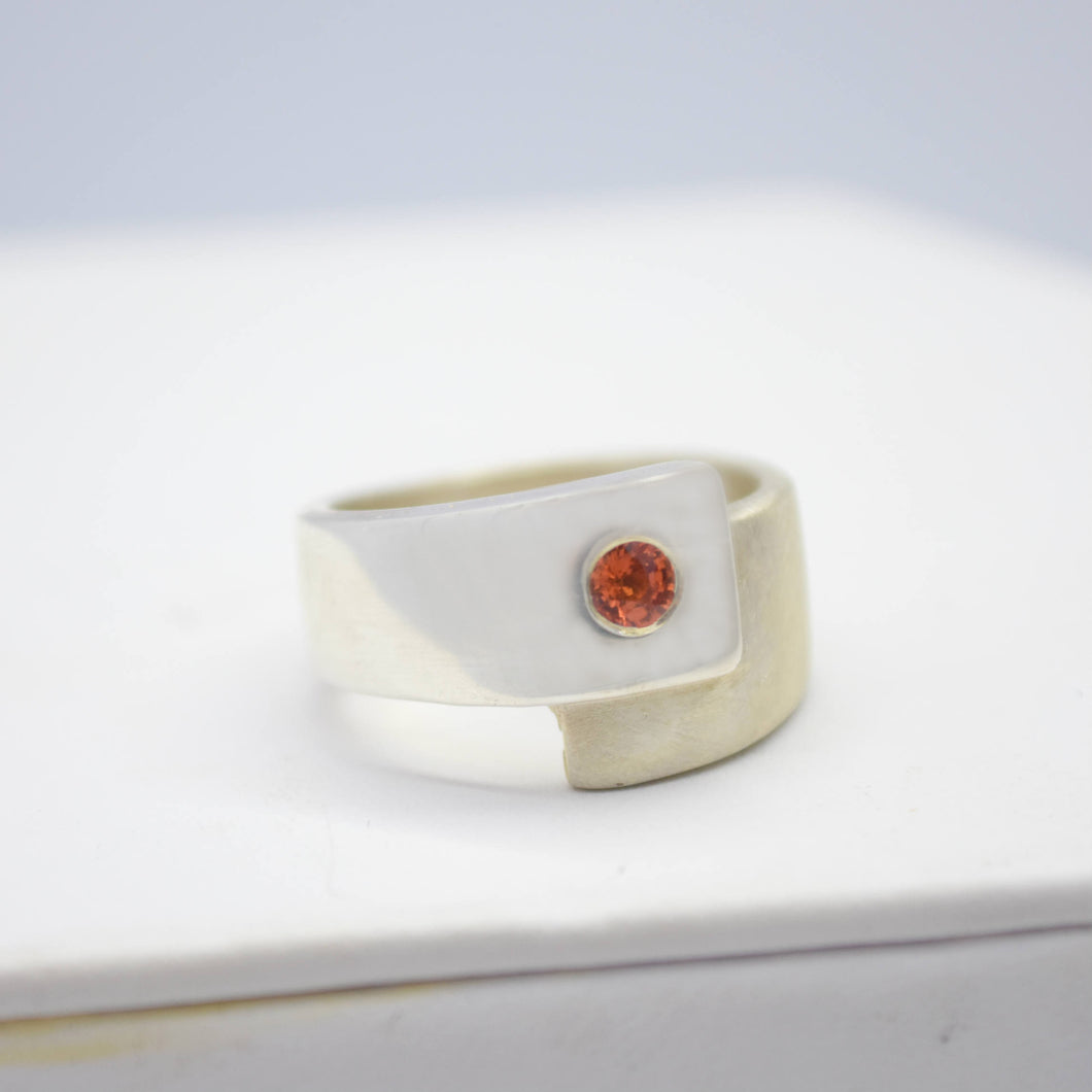 silver wrap ring with orange sapphire