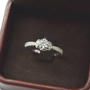 diamond engagement ring with diamond cluster