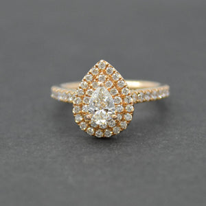 pear shaped double halo rose gold diamond ring