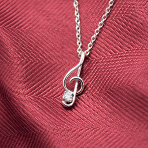 treble clef necklace with lab diamond