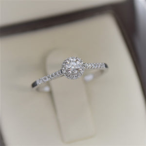 dainty halo engagement ring