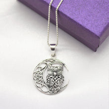 owl on moon necklace in silver