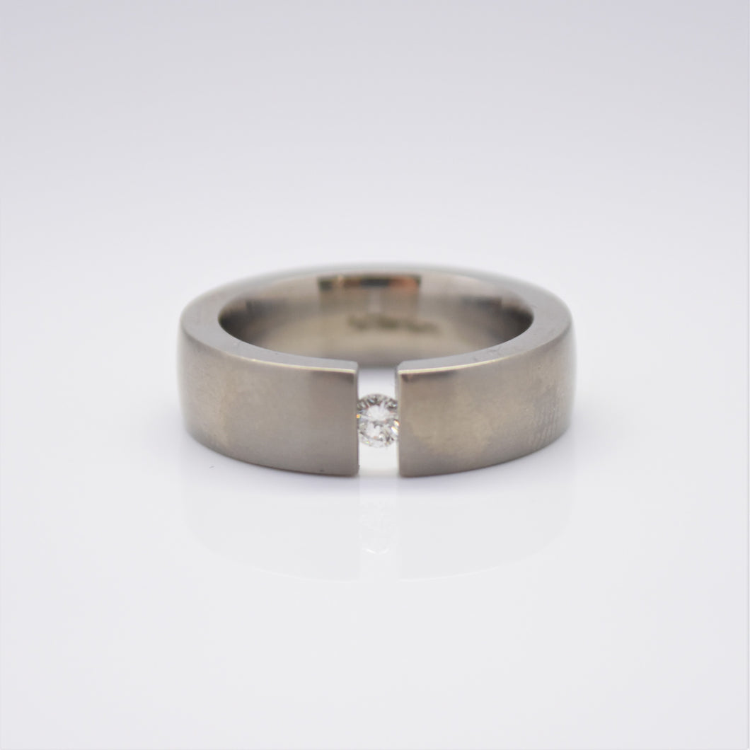 titanium tension set ring with diamond