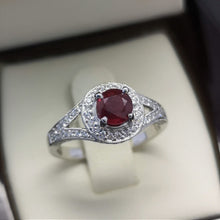 ruby diamond halo ring in white gold