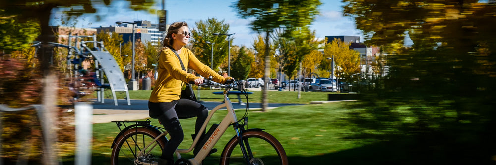 A woman riding a Stunner eBike.