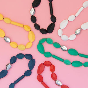 The range of Everyday Long Necklaces in black, white, green, yellow blue & green.