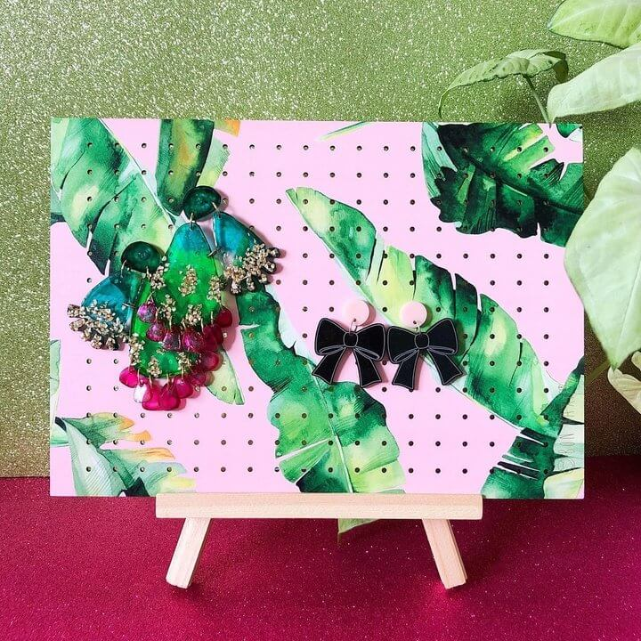 Banana Leaf and pink painted onto a earring Holder