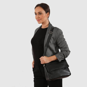 Model wearing the black leather Bryn bag.
