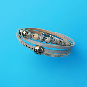 Callie double wrap bracelet with four layers one of them been grey and gold beads.