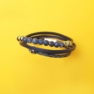 Callie double wrap bracelet has four layers with one been blue and gold beads.