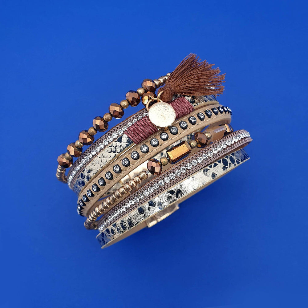 Rich bronze coloured wrap bracelet with small round pendent and bronze tassel.