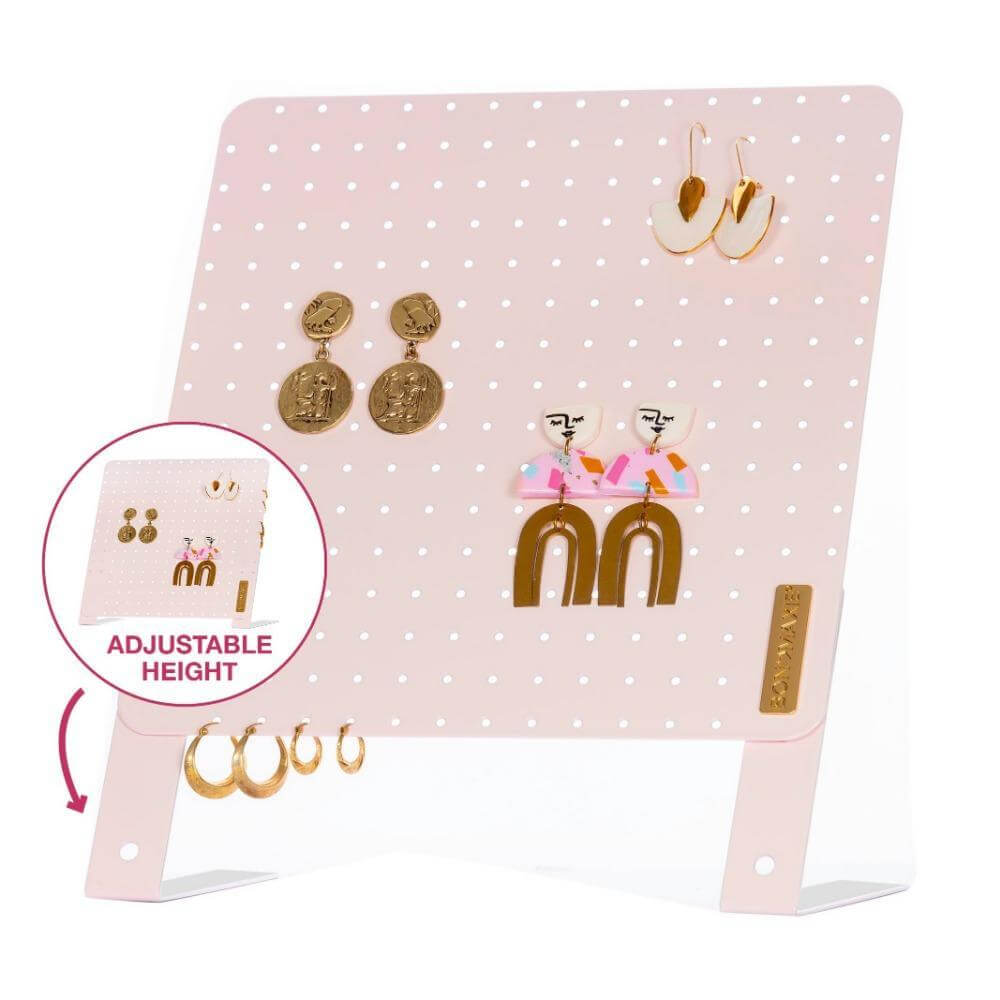 Image shows the box the earring holder stand comes in. It has a picture of the stand with the name and is patterned.