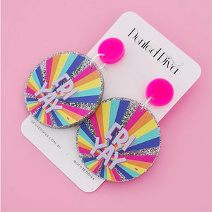 Image shows the FRIYAY earrings on a Dented Diva earring card. The FRIYAY earrings have two drops, the first is a hot pink circle and the second is a large multi coloured rainbow circle with FRIYAY in white text.