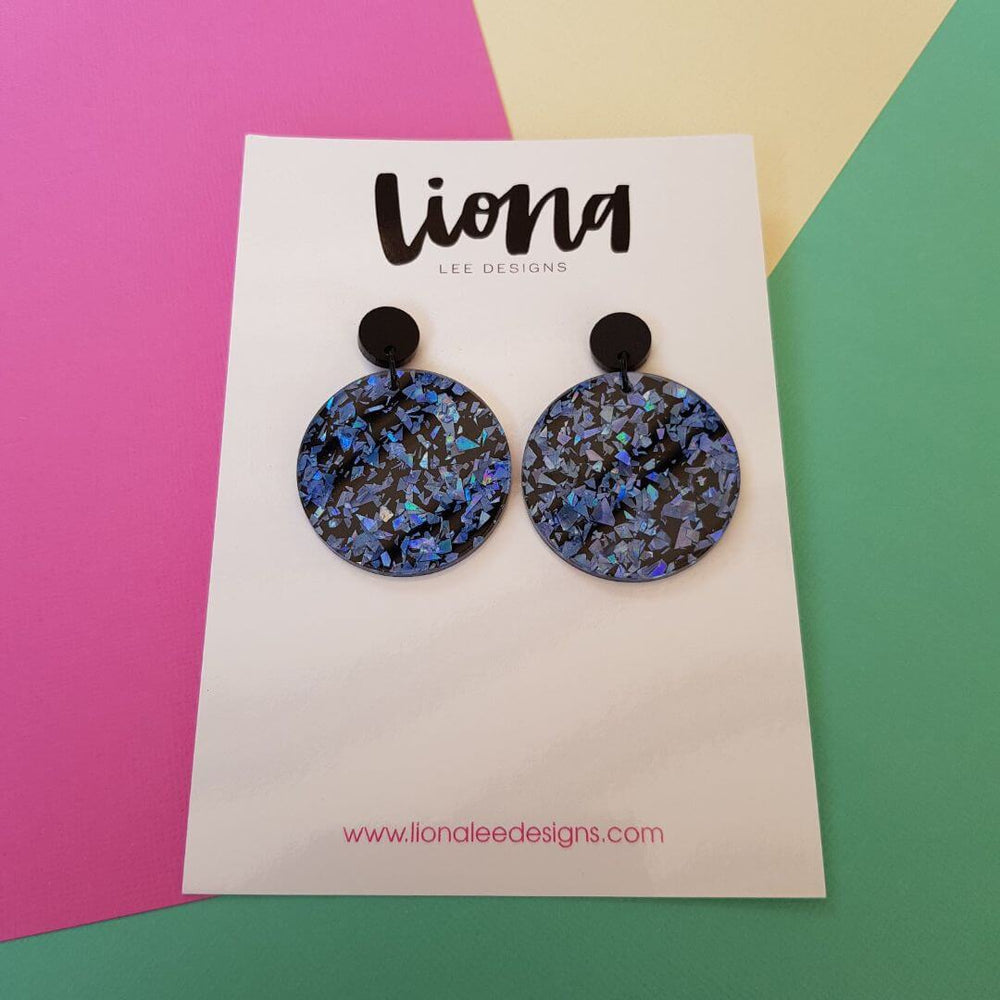 Sparkly blue round statement earrings.