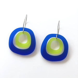 Earrings are on a white background, they have a hoop with two circles in satin translucent acrylic.