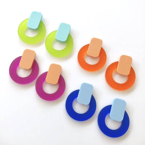 Picture of the Jelly Circle statement stud earrings, there are 4 pairs displayed, green, orange, purple, blue.