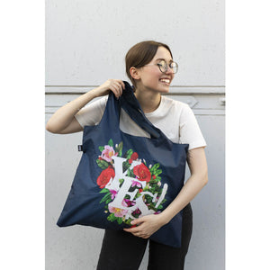Model holding the Yes reusable shopping bag.