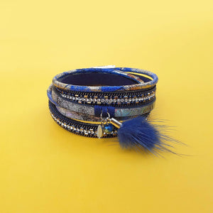 Lulu double wrap bracelet in blue and silver tones with a fluffy tassel and small pendent.  t